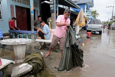 NAKHON SI THAMMARAT, Jan. 5, 2019 (Xinhua) -- Residents clean their house in Pak Phanang district, Nakhon Si Thammarat province of Thailand, Jan. 5, 2019. Tropical storm Pabuk has killed three people and prompted an evacuation of more than 34,000 villagers in southern Thailand, a senior government official said on Saturday. (Xinhua/IANS)