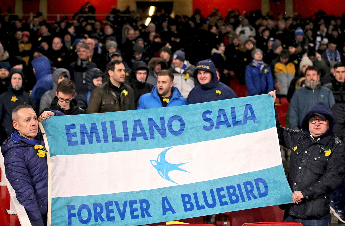 Cardiff City fans in the stands with a flag reading 'Emiliano Sala Forever a Bluebird' during the Premier League match at the Emirates Stadium, London.