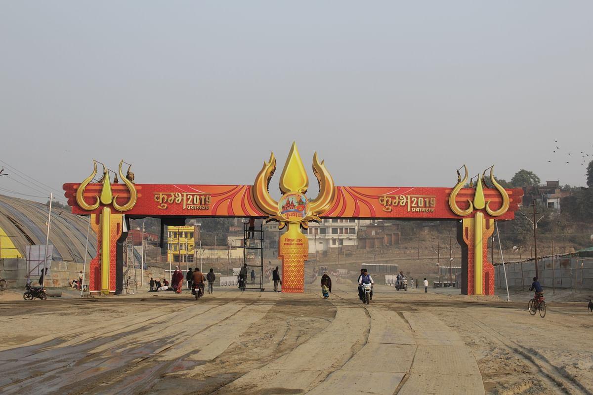 Vehicles pass through the 'Kumbh 2019' entryway.