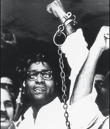 Archival image of George Fernandes in shackles.