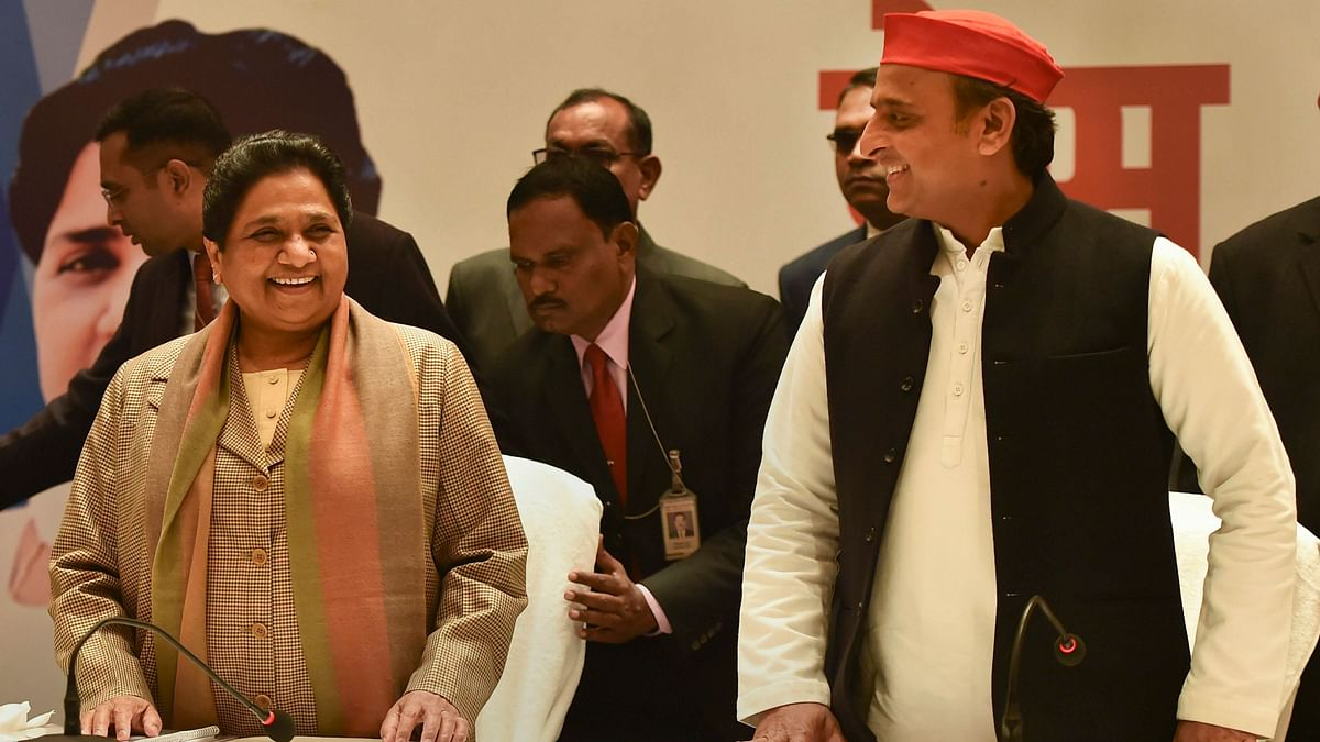 Bahujan Samaj Party leader Mayawati, left, and Samajwadi Party chief Akhilesh Yadav attend a joint press conference in Lucknow.