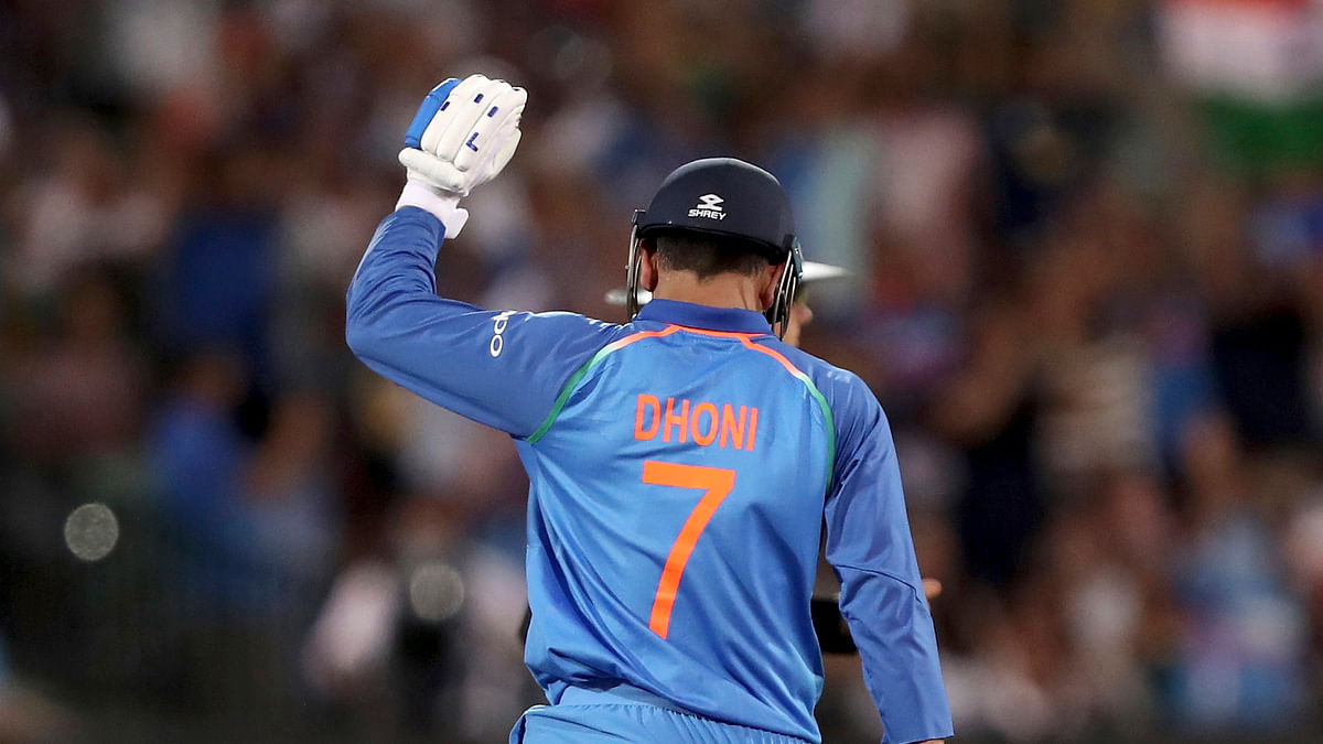 MS Dhoni celebrates after helping India win the third ODI against Australia in Melbourne.