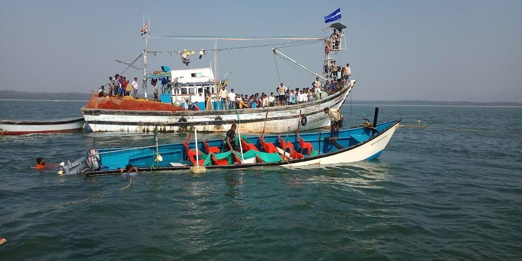 Rescue operations in Karnataka's Karwar after a boat capsized.