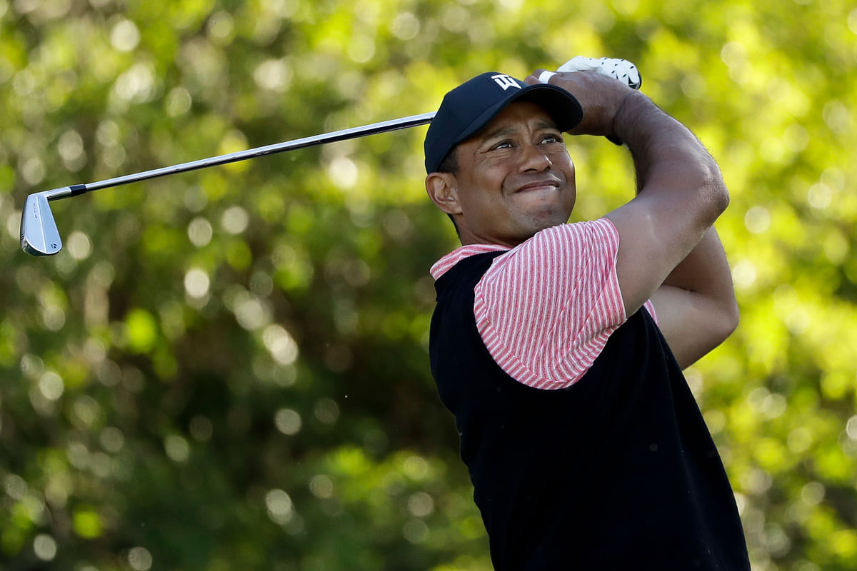 Tiger Woods hits his tee shot on the 11th hole of the South Course at Torrey Pines Golf Course during the final round of the Farmers Insurance golf tournament Sunday, Jan. 27, 2019, in San Diego.