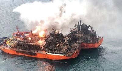 """KERCH STRAIT, Jan. 22, 2019 (Xinhua) -- In this handout photo released by Investigative Committee of the Russian Federation, Russian Emergency Situations ship extinguishes a fire on two Tanzania-flagged vessels """"Kandy"""" and """"Maestro"""" in the Kerch Strait, on Jan. 22, 2019. There is no hope of finding survivors from the ship fire in the Kerch Strait connecting the Black Sea and the Sea of Azov, Russia"""
