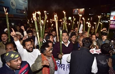 Guwahati: Activists of Krishak Mukti Sangram Samiti (KMSS) participate in a torch light rally to protest against the Citizenship (Amendment) Bill in Guwahati, on Jan 23, 2019. (Photo: IANS)