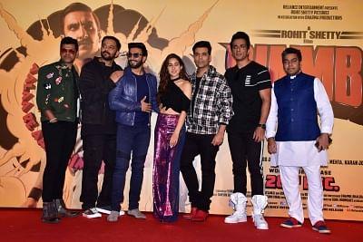 "Mumbai: Director Rohit Shetty and producer Karan Johar with actors Ranveer Singh, Sara Ali Khan, Sonu Sood, Ashutosh Rana and Siddhartha Jadhav at the trailer launch of their upcoming film ""Simmba"" in Mumbai, on Dec 3, 2018. (Photo: IANS)"