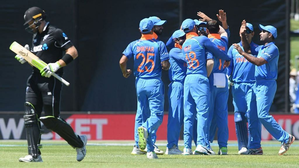 Indian players celebrate the fall of Martin Guptill's wicket during their ODI series opener against New Zealand at Napier.