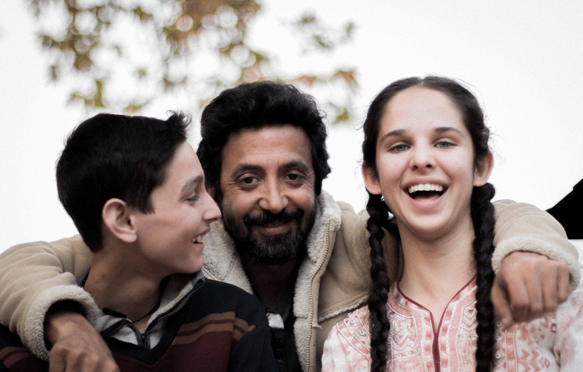 Ashvin Kumar with his actors from <i>No Fathers In Kashmir - </i>Shivam Raina and Zara Webb.