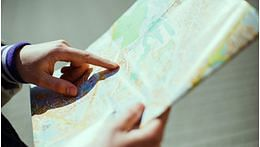 Physically handling a map can help you remember a route better
