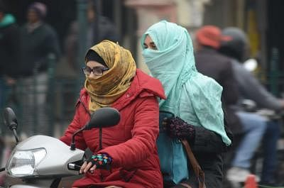 Lucknow: Women wear winter clothes to beat the cold in Lucknow. (Photo: IANS)