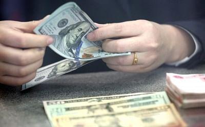 US Dollars. (File Photo: Xinhua/IANS)