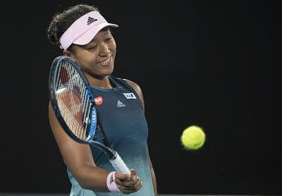 MELBOURNE, Jan. 15, 2019 (Xinhua) -- Naomi Osaka of Japan reacts during the women