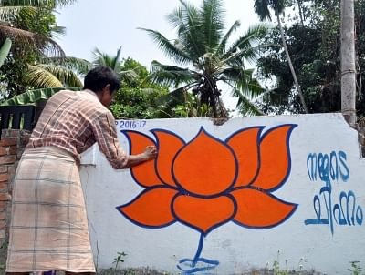 An artist makes graffiti of BJP in Kochi ahead of Kerala assembly polls. (File Photo: IANS)