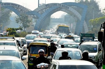 New Delhi: Motorists stuck in a traffic jam near Delhi-Noida border due to a Congress rally against alleged scam in Rafale deal on Jan 30, 2019. (Photo: IANS)