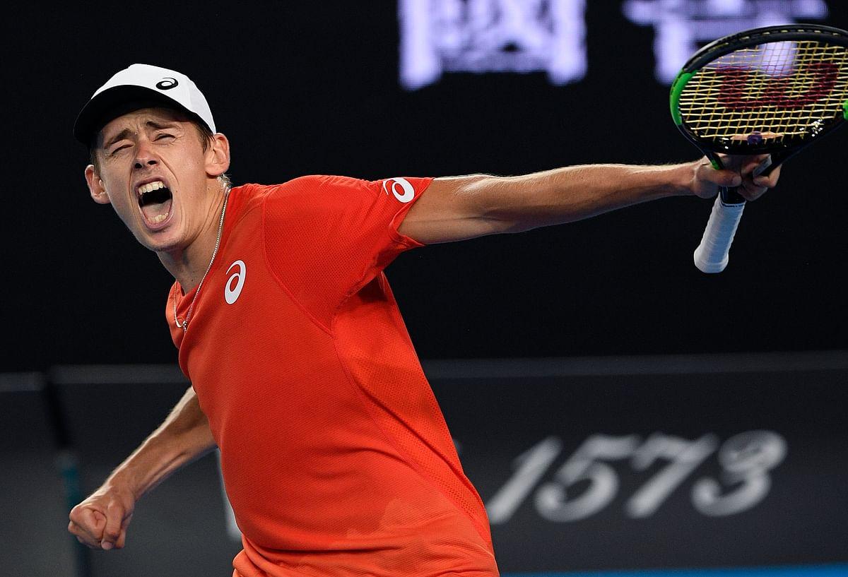Australia's Alex de Minaur celebrates after defeating Switzerland's Henri Laaksonen in their second round match at the Australian Open tennis championships in Melbourne, Australia, Wednesday, Jan. 16, 2019.