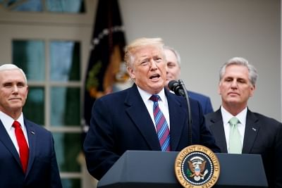 WASHINGTON, Jan. 4, 2019 (Xinhua) -- U.S. President Donald Trump (C) speaks during a press conference at the White House Rose Garden in Washington D.C., the United States, on Jan. 4, 2019. Trump said Friday that he
