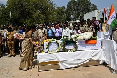Tiruchirapalli: Defence Minister Nirmala Sitharaman lays wreath at the coffin of Sivchandran C, one of the 49 CRPF soldiers killed in 14 Feb Pulwama militant attacks at Tiruchirapalli in Tamil Nadu on Feb 16, 2019. (Photo: IANS)