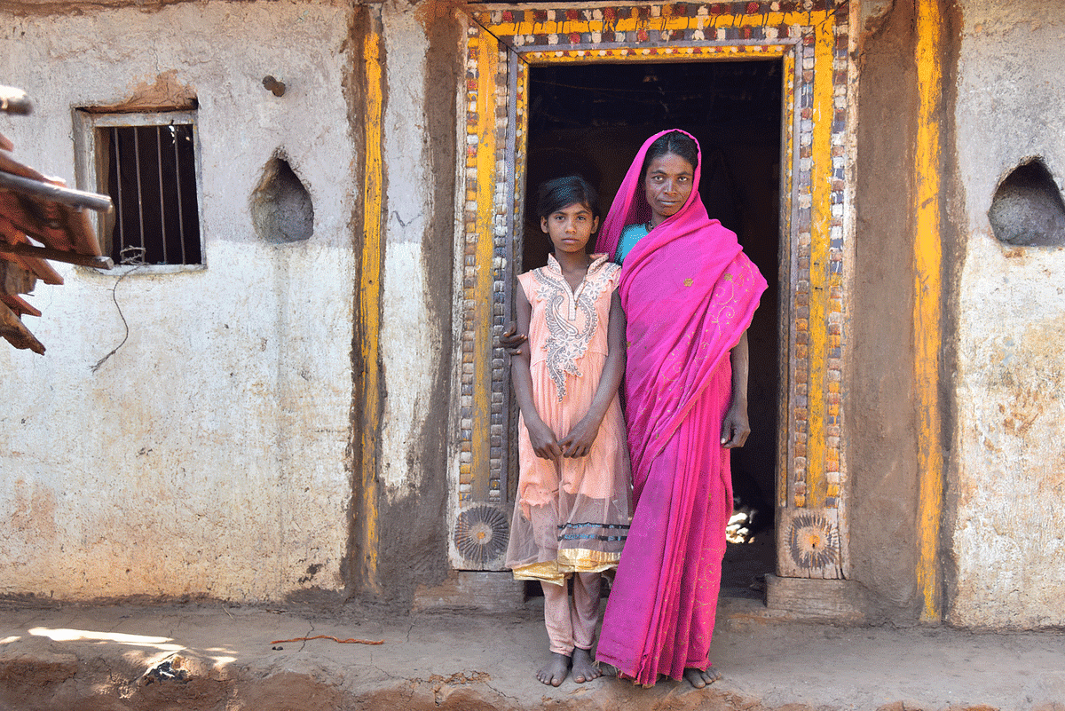 'I do not like that she [Manjula, on the left] is out of school. But her younger sister is enrolled. Only one of them could pursue education,' says Sumanbai Lashke.