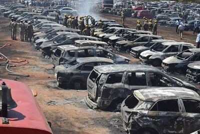 Bengaluru: A view of cars that were gutted in a fire that broke out in the parking lot in front of Yelahanka Air Force Station gutting 300 cars, in Bengaluru on Feb 23, 2019. The fire, which began at around 12 noon, quickly burnt down the vehicles parked by visitors and public attending the show at the Indian Air Force base in the northern outskirts of the city.