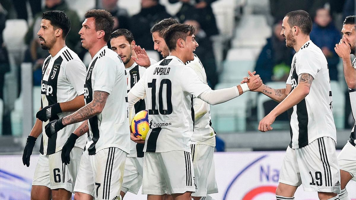 Juventus's Leonardo Bonucci (right) with his team after scoring during the Serie A match against Frosinone at the Allianz Stadium in Turin, Italy on Friday.