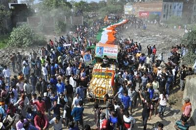 Masurhai: People in large numbers participate in the last rites of martyr Sanjay Kumar Sinha, one of the 49 CRPF personnel killed in 14 Feb Pulwama  militant attacks in Masurhai, Patna district, Bihar on Feb 16, 2019. (Photo: IANS)