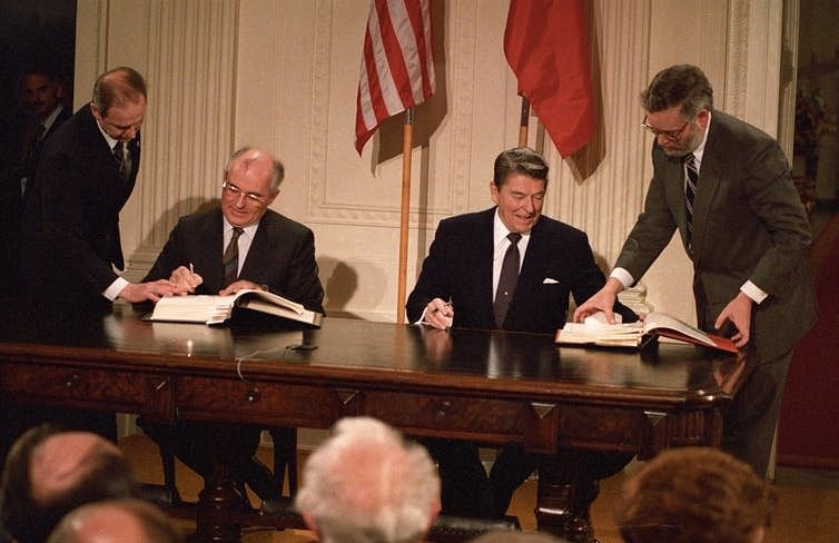 US President Ronald Reagan, right, Soviet President Mikhail Gorbachev sign the Intermediate-Range Nuclear Forces Treaty in the White House.