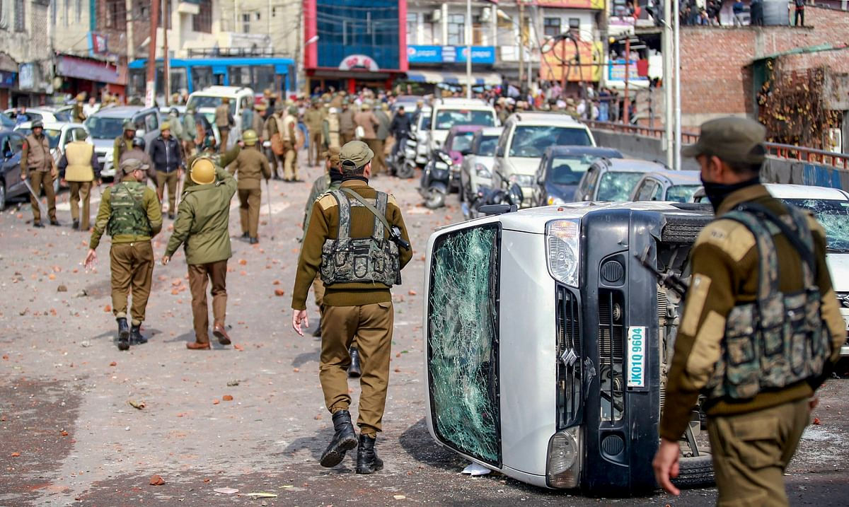Security personnel patrol a street after vehicles set on fire by protestors against the killing of CRPF personnel in the Pulwama terror attack in Jammu.