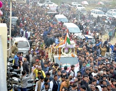 Mathura: A huge crowd gathered as the body of CRPF soldier Kaushal Kumar Rawat who was martyred in the Pulwama terror attack, reached his native village Kahari, near Mathura on Feb. 16, 2019. (Photo: IANS)
