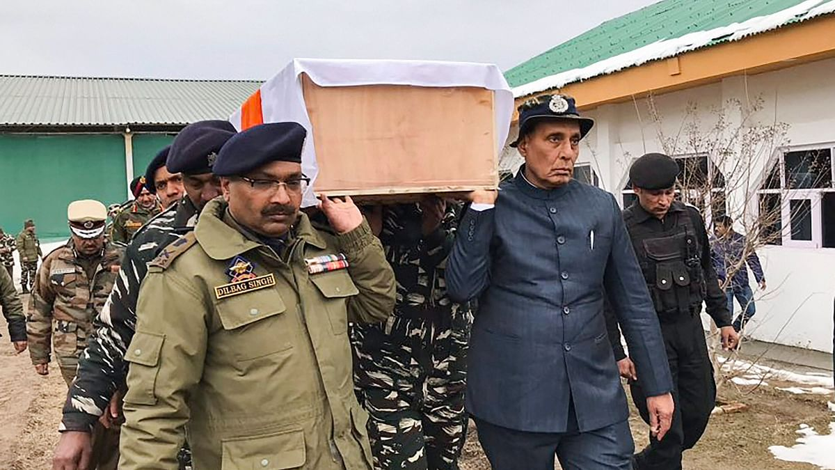 Forty CRPF personnel were killed after a car carrying explosives hit a CRPF convoy in Jammu and Kashmir's Pulwama. Home Minister Rajnath Singh carrying the mortal remains of one of the CRPF jawans.
