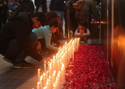 New Delhi: People pay tribute the 49 CRPF men killed in 14 Feb Pulwama militant attack, at a Delhi mall on Feb 16, 2019. (Photo: IANS)