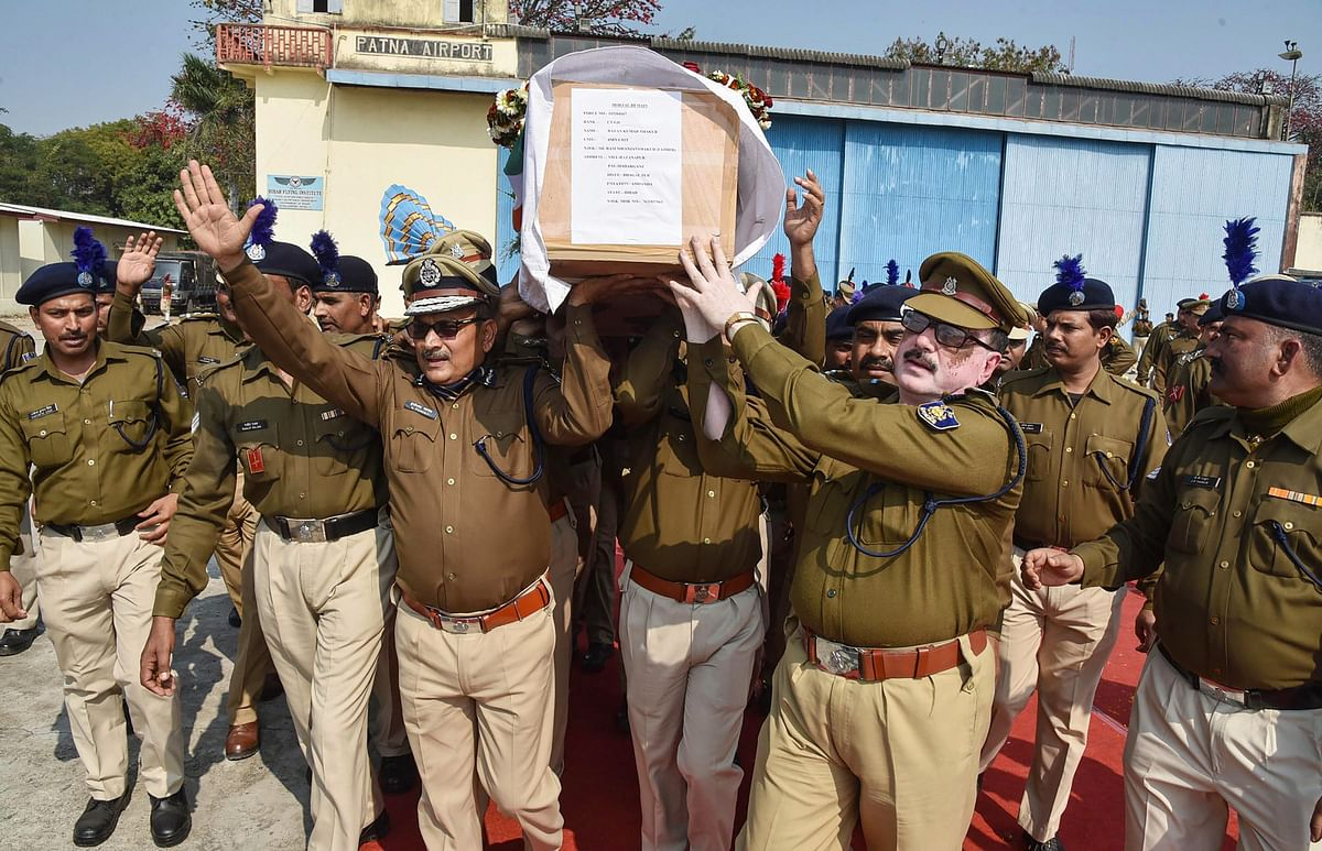 DGP Gupteshwar Pandey and police personnel carry the coffin of  slain CRPF jawan Ratan Thakur for last rites, in Patna.