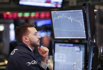 NEW YORK, Feb. 5, 2018 (Xinhua) -- A trader works at the New York Stock Exchange in New York, the United States, on Feb. 5, 2018. U.S. stocks closed sharply lower on Monday, with the Dow plummeting 4.60 percent, as the market took a heavy hit from panic sales. (Xinhua/Wang Ying/IANS)