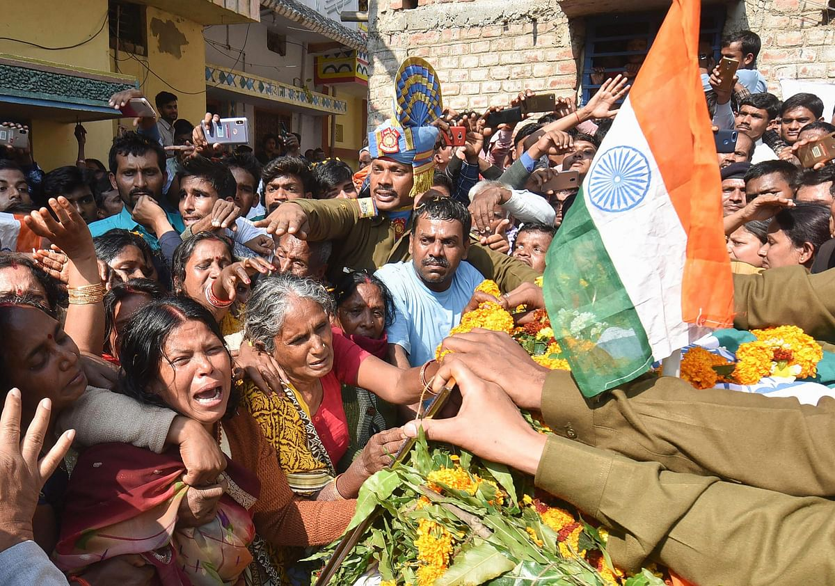 Family members of slain CRPF Sanjay Kumar Singh pay their last respects before the funeral procession, at Masaurhi, in Patna on 16 February 2019.