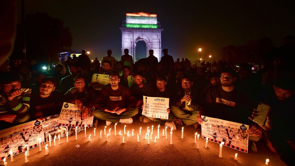 People participate in a candle light march to offer tributes to the martyred CRPF jawans of Pulwama terror attack.