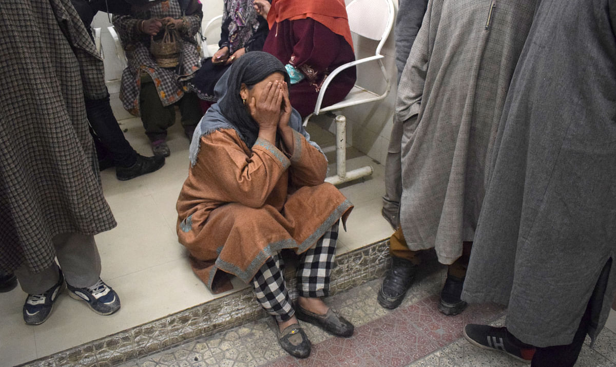 A woman breaks down after an explosion in a Pulwama school leaves several students injured.