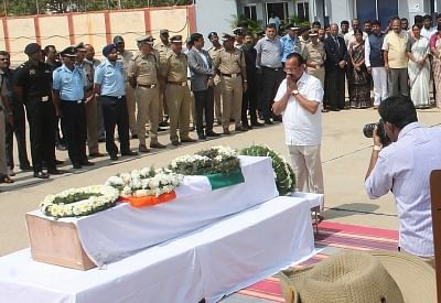 Bengaluru: Union Minister DV Sadananda Gowda pays tribute to Guru H who was among the 49 CRPF personnel killed 14 Feb Pulwama militant attack, in Bengaluru on Feb 16, 2019. (Photo: IANS)