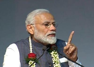 New Delhi: Prime Minister Narendra Modi addresses during Gita Aradhana Mahotsav at the ISKCON temple in New Delhi on Feb 26, 2019. (Photo: IANS)