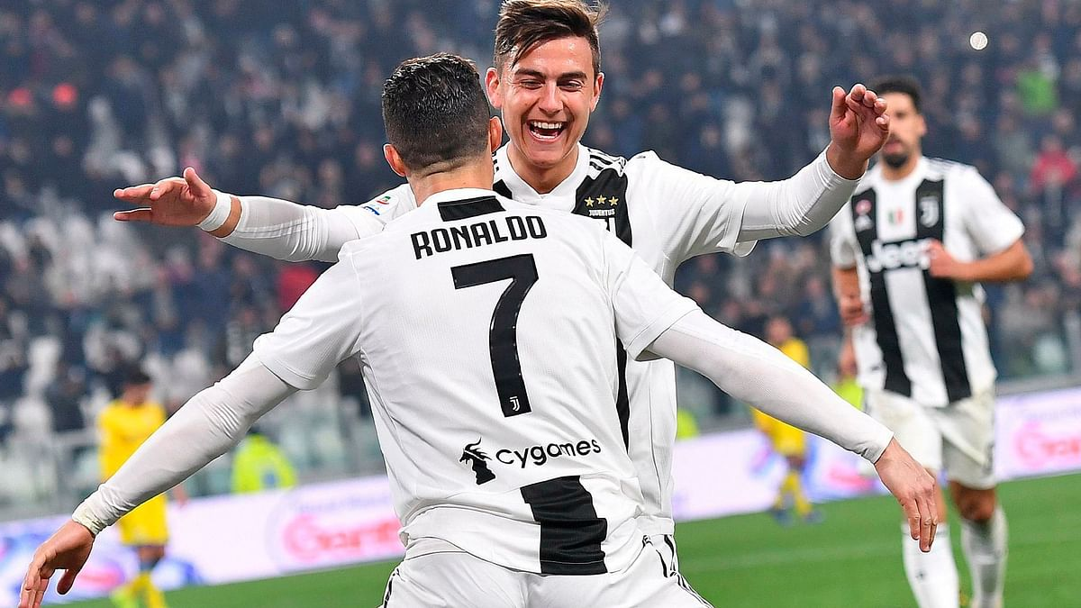 Juventus' Cristiano Ronaldo celebrates with his teammate Paulo Dybala after scoring during the Serie A match against Frosinone at the Allianz Stadium in Turin, Italy on Friday.