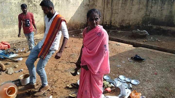 Khamrunissa watches in despair while miscreants destroy her food stall on 31 January in Sakleshpur.