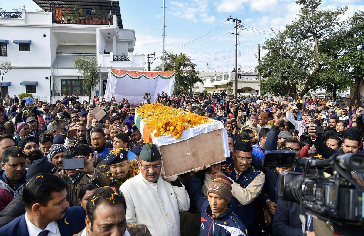 Uttarakhand Chief Minister Trivendra Singh Rawat paid his last respects to CRPF jawan Mohan Lal after the wreath-laying ceremony, in Dehradun on 16 February 2019.