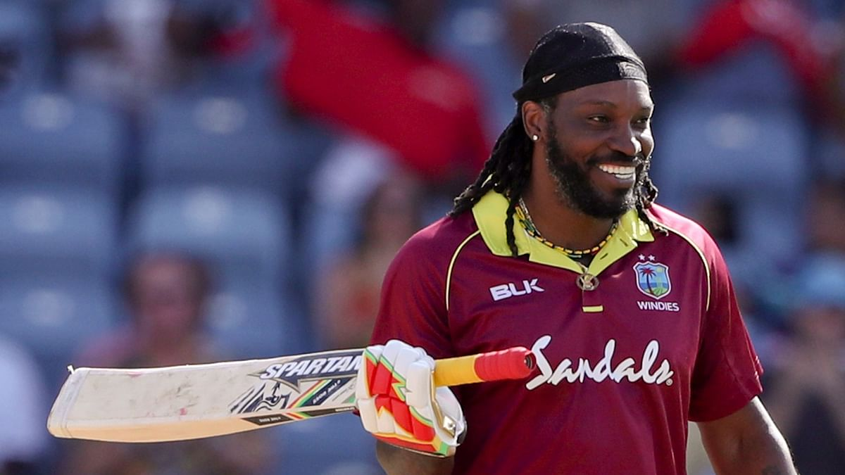 West Indies' Chris Gayle celebrates after scoring a century against West Indies during the fourth One Day International at the National Stadium in St. George's, Grenada, Wednesday, Feb. 27, 2019.