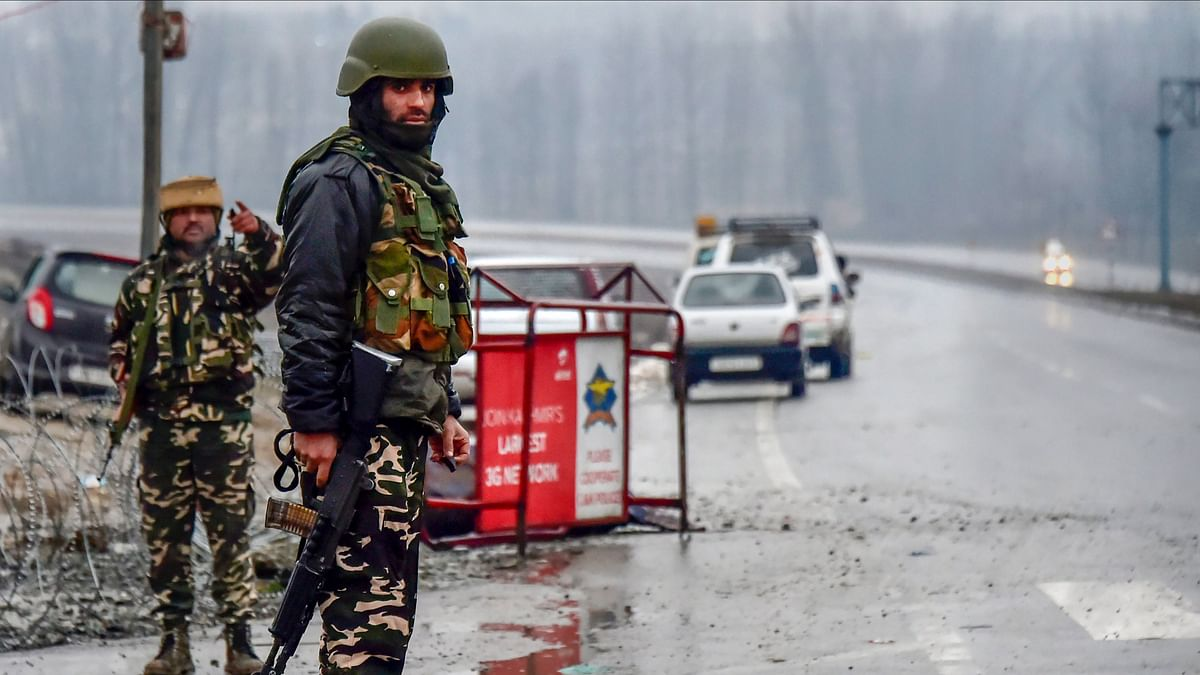 A file photo of Army soldiers standing guard near the site of suicide bomb attack at Lathepora Awantipora in Pulwama district on 14 February.