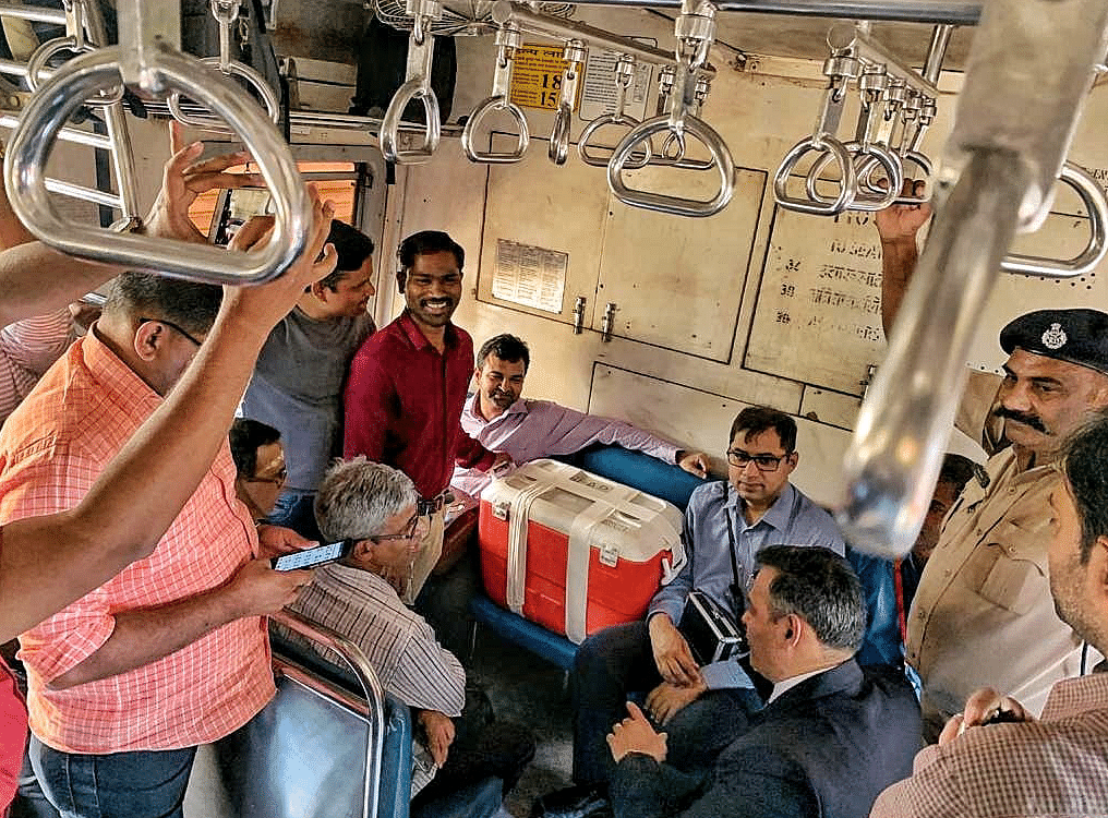 The transplant team on the train with the organ.