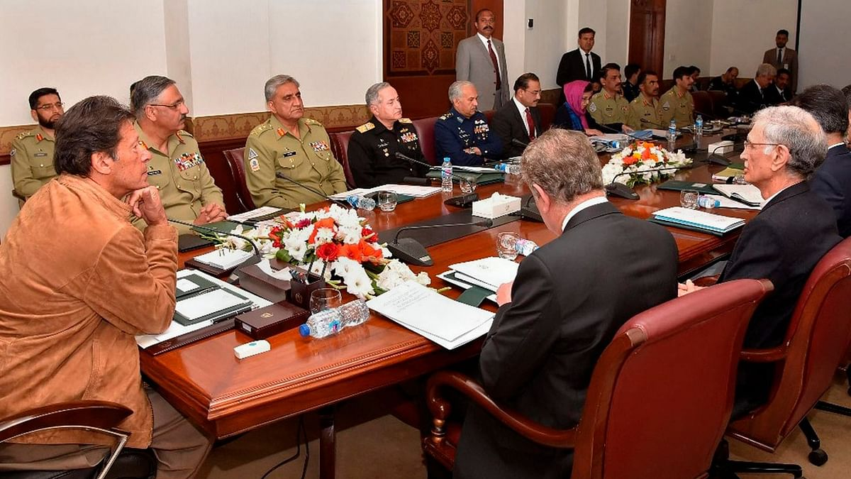 Pakistan PM Imran Khan chairs a meeting of the National Security Committee in Islamabad on 21 February.