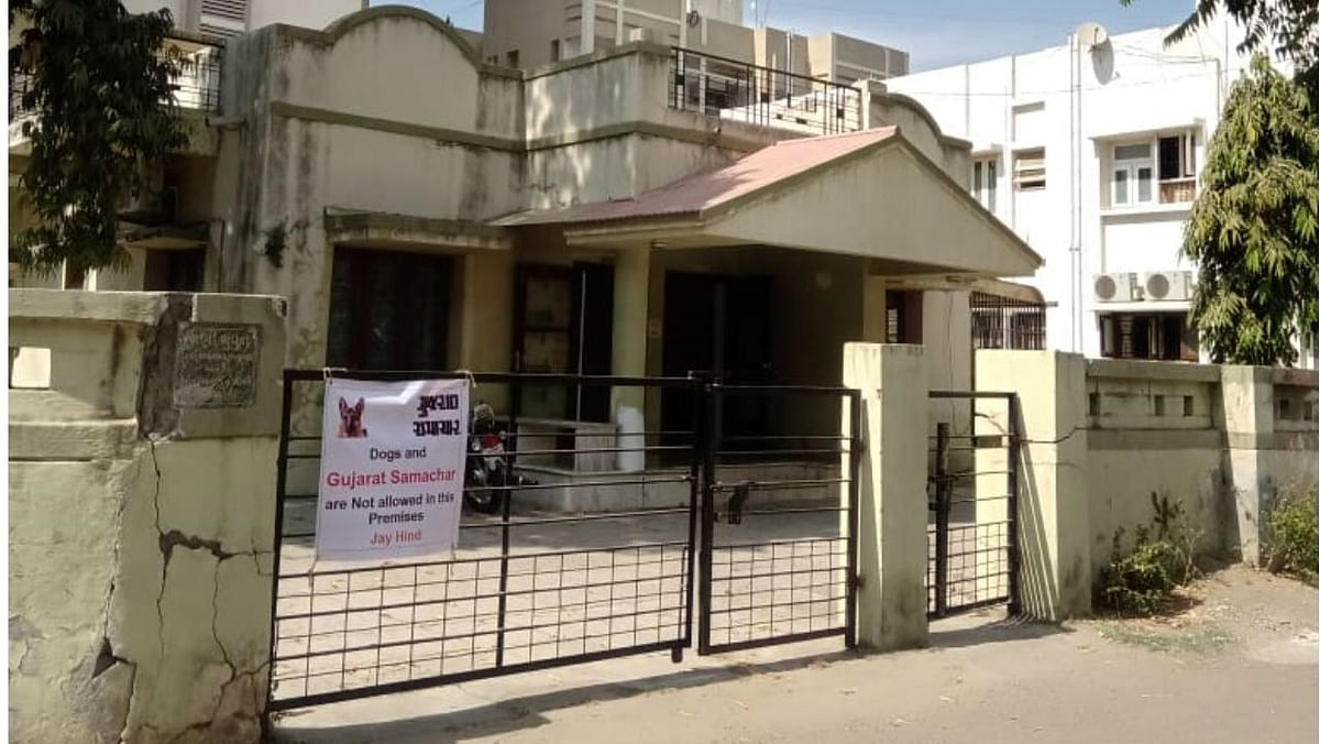 """A house in Sabarmati area of Ahmedabad with a banner on its gate that states """"Dogs and Gujarat Samachar"""" are not allowed in the premises."""