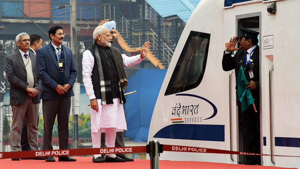 Prime Minister Narendra Modi flags off Vande Bharat Express, India's first semi-high speed train, at New Delhi Railway Station.