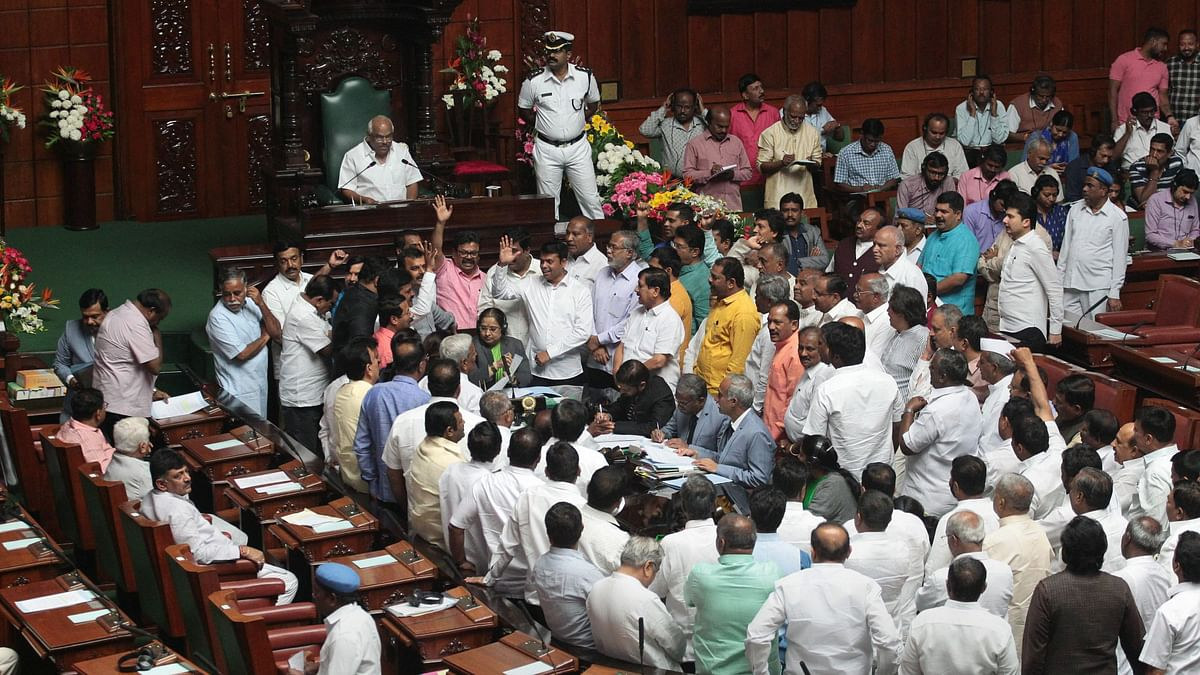 BJP MLAs storm the well of the house.