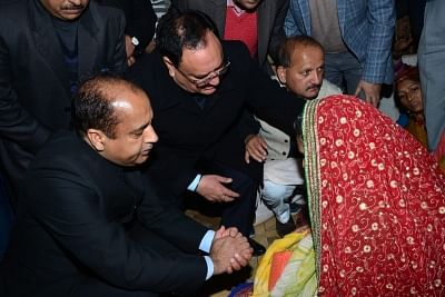 Kangra: Himachal Pradesh Chief Minister Jai Ram Thakur and Union Health Minister JP Nadda console the family of martyr Tilak Raj, who was among the 49 CRPF personnel killed in a suicide attack by militants in Jammu and Kashmir