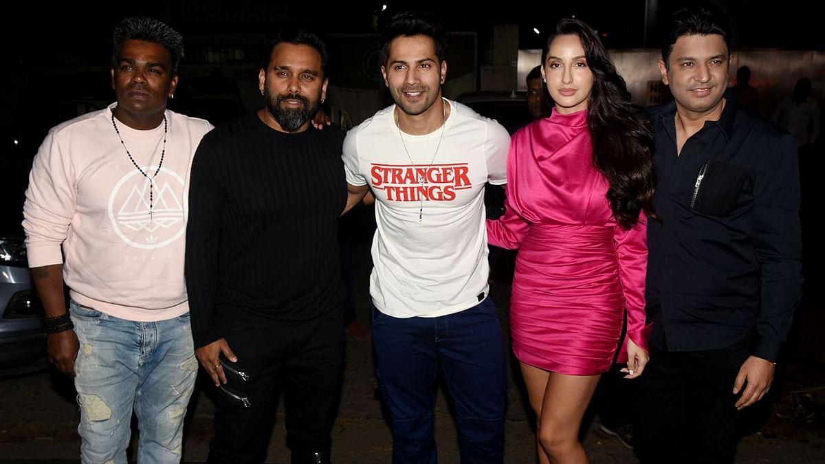 Varun Dhawan, Bosco-Caesar and producer Bhushan Kumar at Nora's birthday.